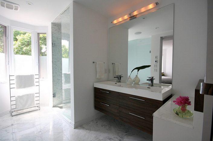 Floating wooden vanity in the bathroom mirror