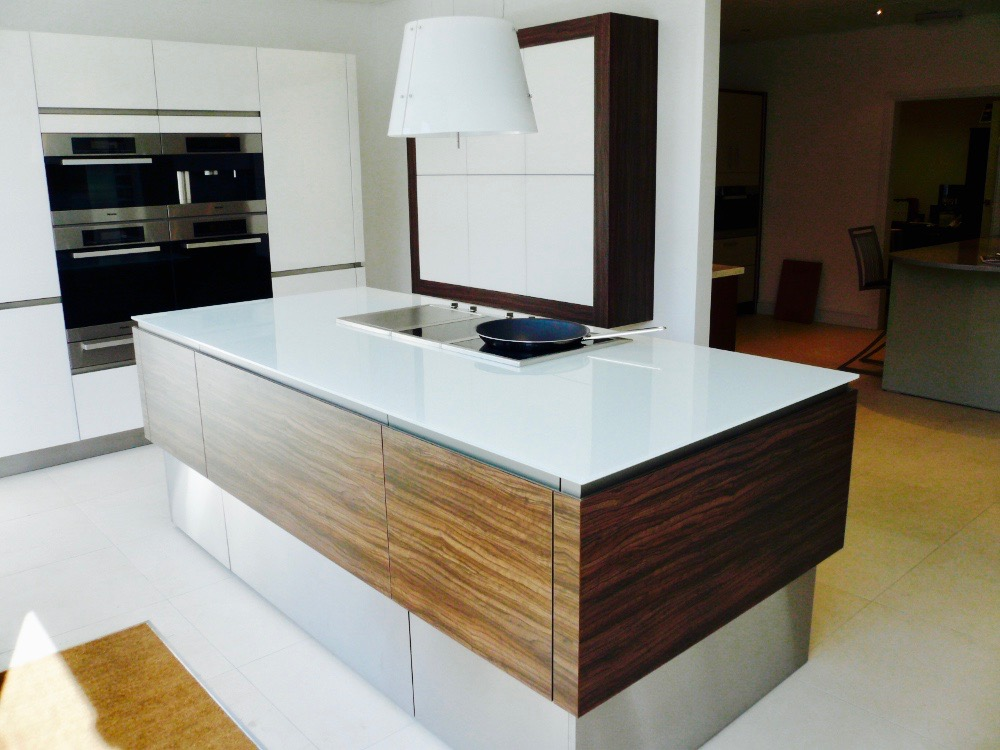 white glass kitchen island unit glass counter top